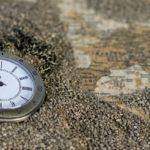 Köppinen Oy - kello ja maailman kartta